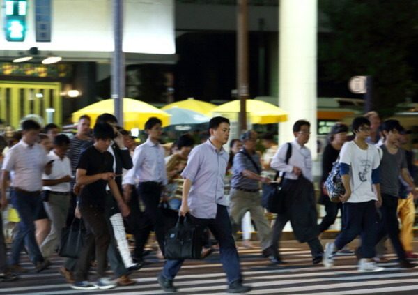 Workers In Central Business District As Japan Releases Jobless Rate Figures